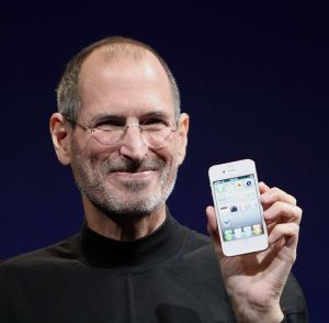 Steve Jobs holding a white iPhone 4 at Worldwide Developers Conference 2010.