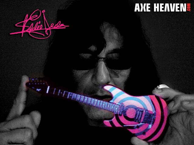 Eddie Ojeda Holding Licensed Miniature Guitar by AXE HEAVEN®