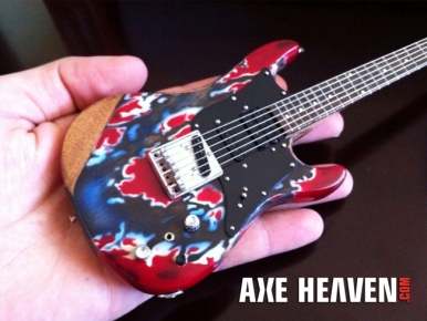 The AXE HEAVEN Erik Buell Miniature Guitar is detailed with metal strings, pegs and pickups.