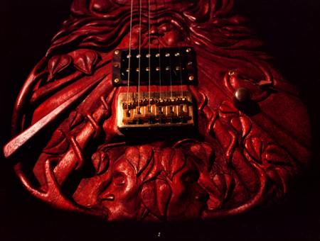 Life - the faces at the bottom represent earth to earth, ashes to ashes - McSwain Guitars