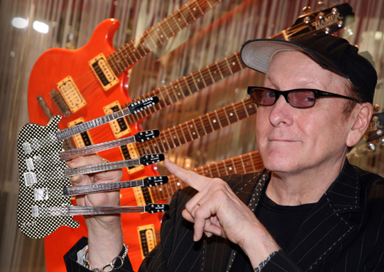 Rick Nielsen with His Officially Licensed RICK NIELSEN™ Five-Neck Checkered Mini Guitar Replica Collectible by AXE HEAVEN®