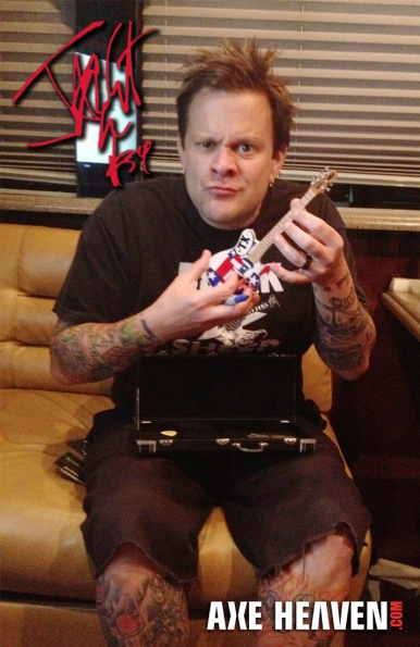 Jaret Reddick takes a break, while autographing limited-edition promo giveaways, to play his 'Texas' mini live on an office couch.