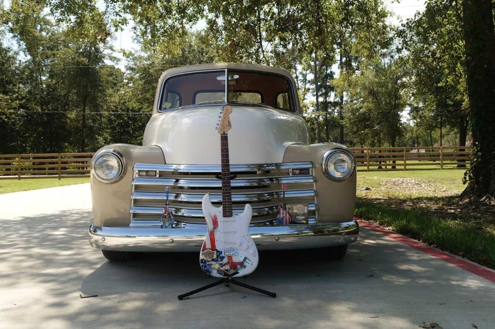 "Classic pickup truck with Guitars N' Cars' real promo Fender™ guitar, 10"" custom promo mini guitar, and glass frame award by AXE HEAVEN®."