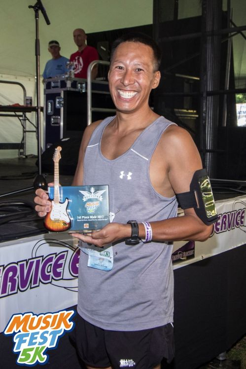 MusicFest 5K 1st Place Male 2017 Holds Rockstar Trophy by AXE HEAVEN® - Photo ©myEPevents