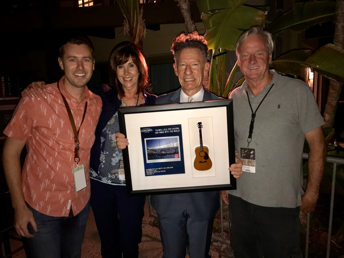 Lyle Lovett Holds His Shadowbox by Axe Heaven