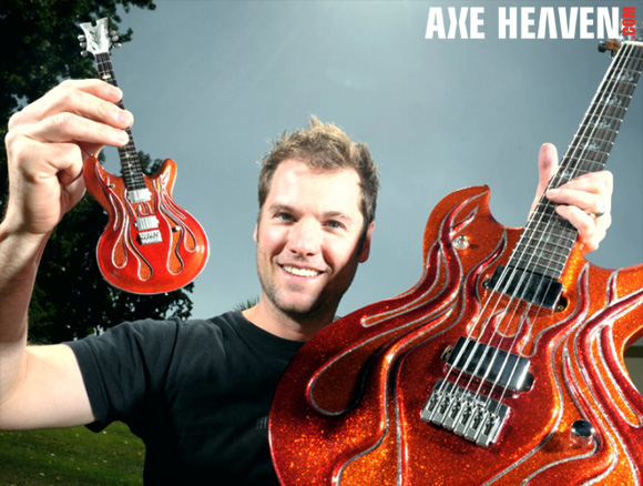 Stephen McSwain - an AXE HEAVEN® Exlusive Artist - Holding Licensed Miniature Flame Guitar by AXE HEAVEN® and Original Flame Guitar by McSwain Guitars