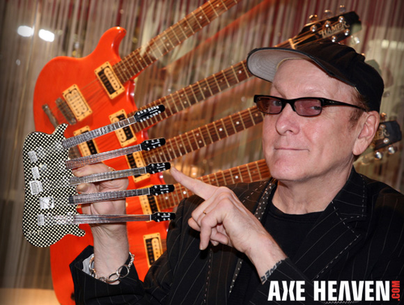 Rick Nielsen - an AXE HEAVEN® Exlusive Artist - Holding Officially Licensed Checkered Five-Neck Miniature Guitar Replica Collectible by AXE HEAVEN®