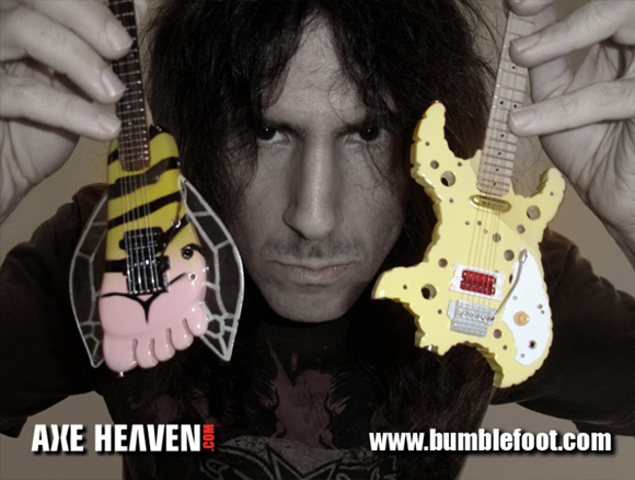 Ron Thal - an AXE HEAVEN® Exlusive Artist - Holding Licensed Miniature Bumblefoot and Swiss Cheese Guitars by AXE HEAVEN®