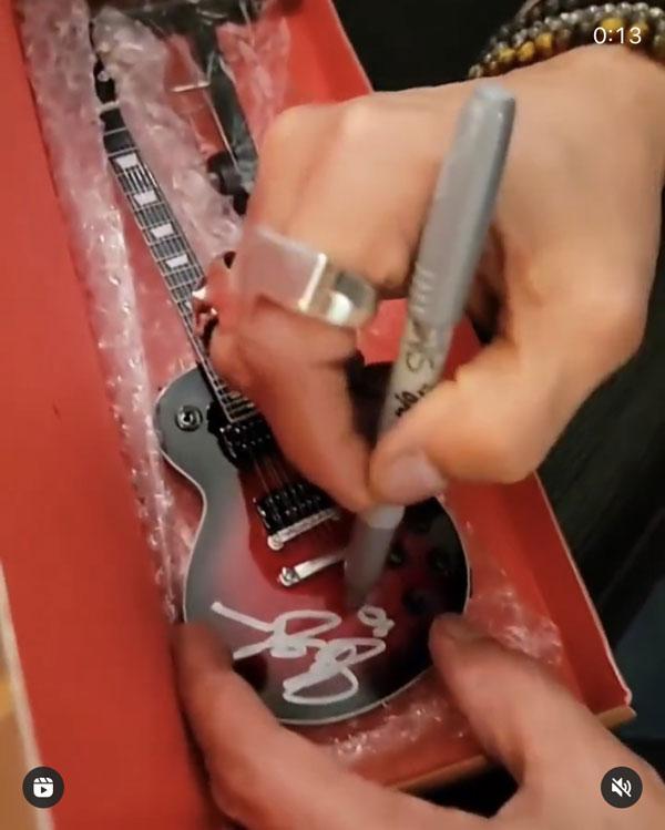 Slash Signing Gibson Mini Guitar